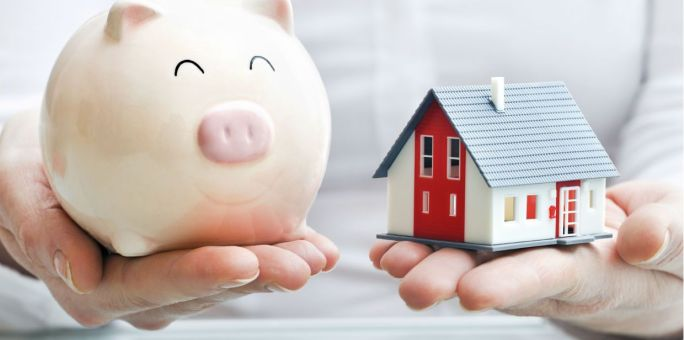 hands-holding-piggy-bank-and-house_iStock_2